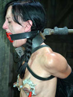 Brunette shackled and tortured