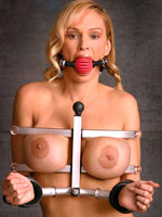 Blonde pornstar about shackled breast