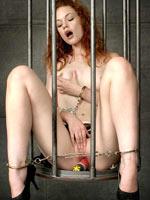 Caged redhead pornstar