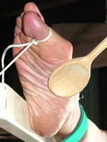 Bastinado with wooden spoon
