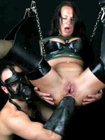 Suspended anal fisting in a love swing