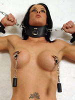 Brunette posing on BDSM boxing-match