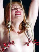 Redhead slut gets nipple torture