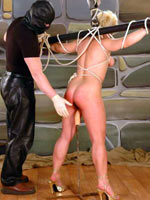Tied up blonde gets dildo