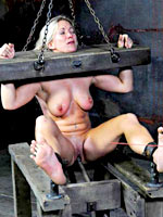 Blonde sub girl shackled and hanged