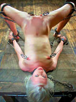 Blonde girl in shackles