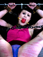 Brunette girl on bondage session