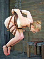 Inexperienced blonde suspended on chains