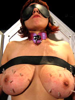Red-haired slave gets tits torture